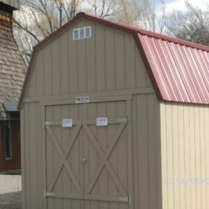 Loft Style wood shed with double doors and a red metal roof